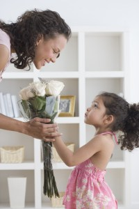 Girl Giving Her Mother Bouquet of Roses